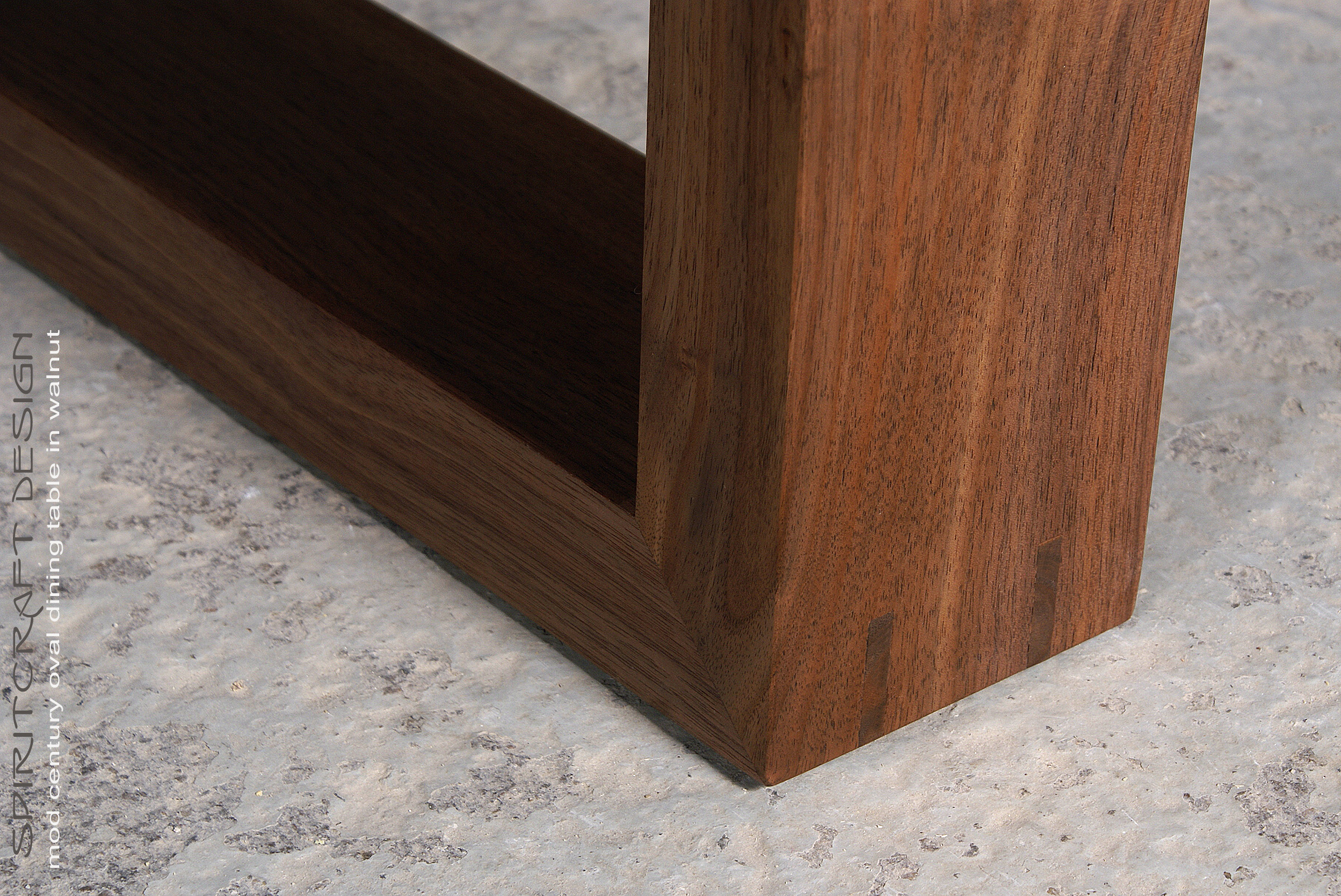 Timeless Design meets Enduring Quality in a Modern Walnut Dining Table