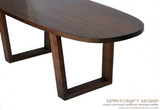 Interior Design Accents - Solid Black Walnut dining room table in a mid century influenced style for North Shore client by Spiritcraft Design Furniture of East Dundee, Illinois