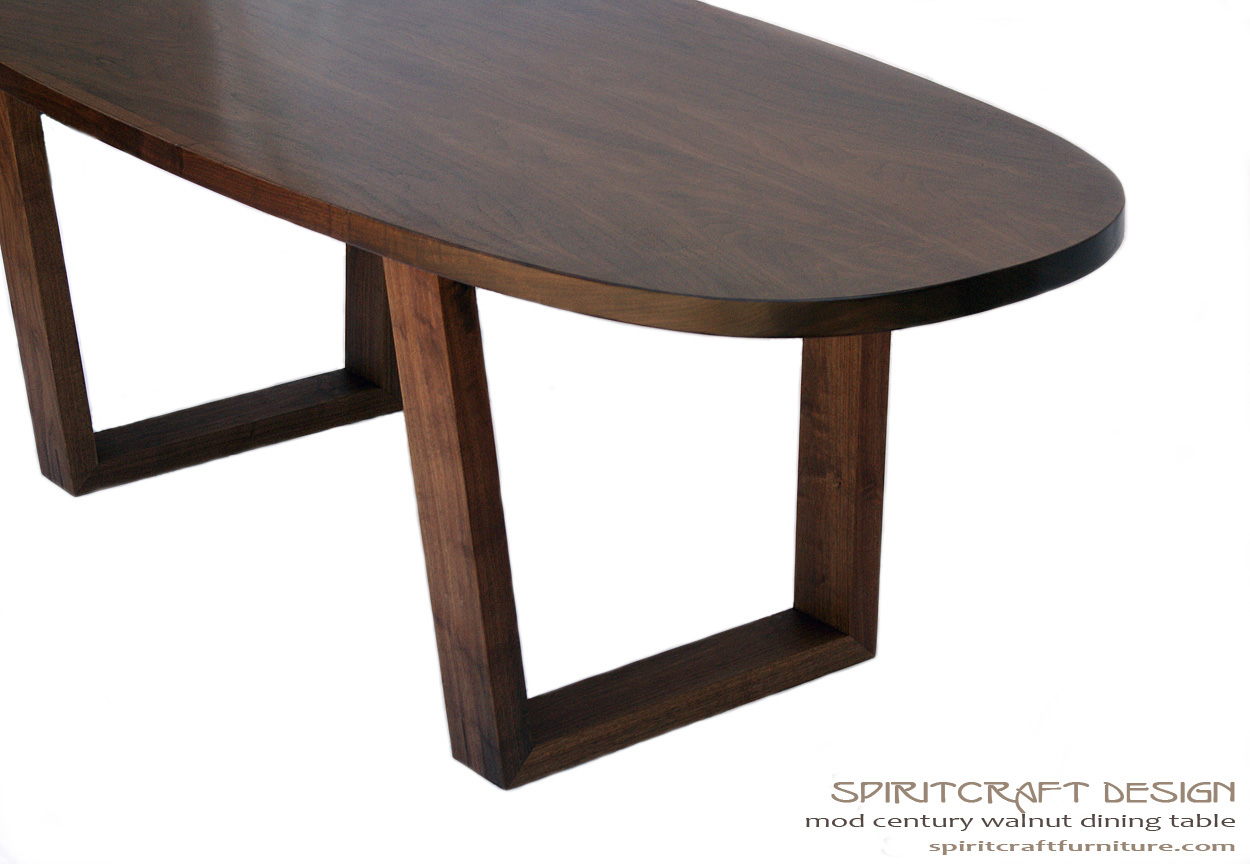 Timeless design meets enduring quality in a modern walnut Oval dining table