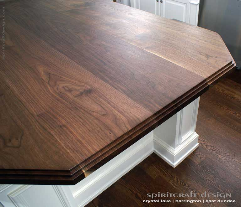 Interior Design Accents - Solid hardwood Walnut slab kitchen island top in Glenview, Illinois by Spiritcraft Design Furniture of East Dundee, IL