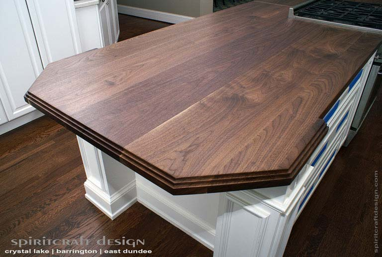 Interior Design Accents - Stunning solid Black Walnut hardwood slab kitchen island top in Glenview, Illinois by Spiritcraft Design of East Dundee, IL