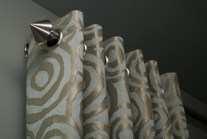 Custom draperies with grommets and contemporary drapery rods