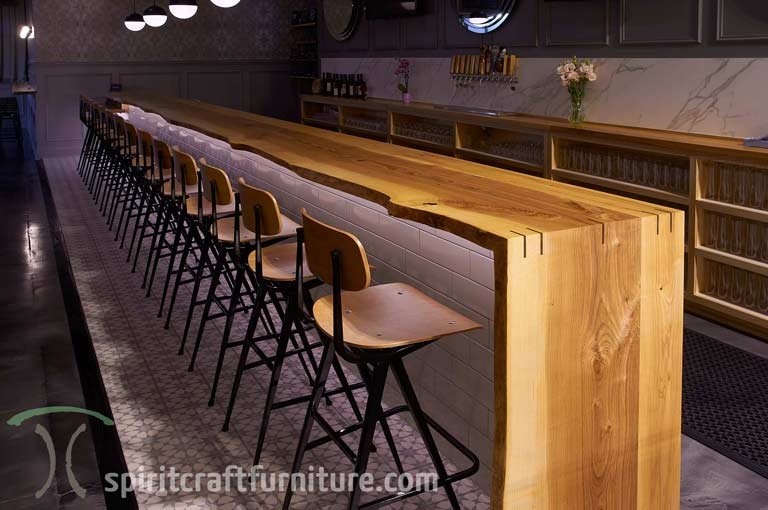 Live edge Ash bar top from kiln dried slabs for Chicago area brewery and restaurant